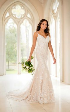 19a12660f8c Stella York Bridal 6677 Have a classic bridal moment in this lace  fit-and-flare wedding dress by designer Stella York. The soft