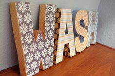 letters modge podged with scrapbook paper