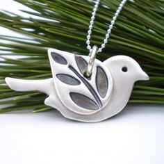 Silver Bird Pendant With Leaf Wing Silver Leaf by AliBaliJewellery Clay Birds, Ceramic Birds, Ceramic Clay, Ceramic Pottery, Ceramic Pendant, Ceramic Jewelry, Polymer Clay Jewelry, Leaf Pendant, Polymer Clay Projects