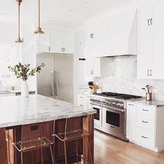 White kitchens are my jam  • loving the lucite stools and glass pendants