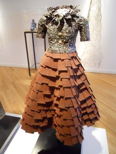 Skirt made of roofing shingles... That's a roofer with too much time on his hands.