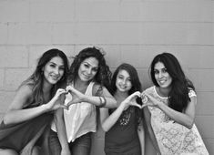 Four Sisters. Making Hears With Their Hands. So Cute. Love Is In The Air. Brunettes. Black and White.