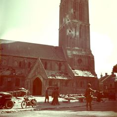 A Canadian Soldier directing traffic in Bernières-sur-Mer in front of the church on the afternoon of D-Day.