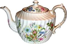 Google Image Result for http://www.teainfusion.com/system/files/images/flowers-teapot.preview.jpg