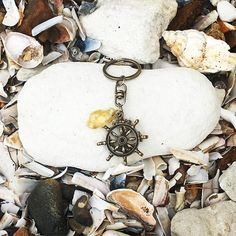 Beautiful Anchor & Ship Wheel with Amber Tumble Keyring, perfect unique gift. Accessory for keys or handbag amberparadisejewellery accessory # Anchor Jewelry, Nautical Jewelry, Ship Wheel, Sailing Adventures, Amber Stone, Baltic Amber, Gifts For Dad, Keys, Unique Gifts