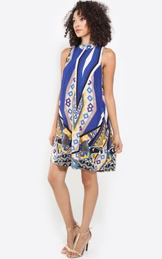 This refreshing geometric tribal print dress is perfect to wear day or night. I MakeMeChic.com