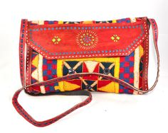 Leather flap tablet bag made up of Kutch leather flap tablet bag made up of Kutch purse snap button closing. Inside lining & top zip closing with inside one small zip pocket.  #Buyhandbagsonline #HandmadeHandbags #Authenticdesignerhandbags #Womenswallets #Pursesonline #Handmadeitems #Styleincraft