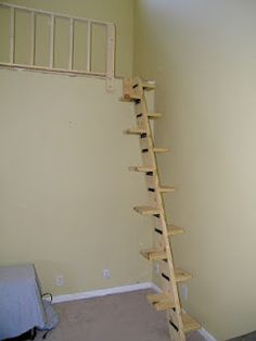 Create a loft space in the vaulted ceiling area above the stairs with retractable ladder to get to it?