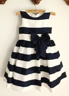 The dress is made of high quality taffeta fabric.It is a little navy style,suitable for beach or country themed wedding,your girls can wear in daily life as well.We just closed the back in a simple zipper.The bow is in navy blue color and in taffeta as well.For Custom Dress,please enter the measurem