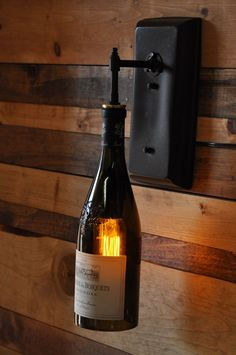 Wine bottle wall sconce made by heirloom claremont