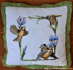 Embroidered pillow with birds