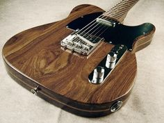 Fender Telecaster Solid Rosewood- This is such a pretty guitar! I want it!!