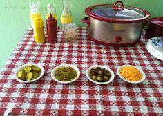 Hot Dog Bar - Crockpot for warming, hot dogs, buns, relish, onions, cheese, sauerkraut, ketchup, mustard.