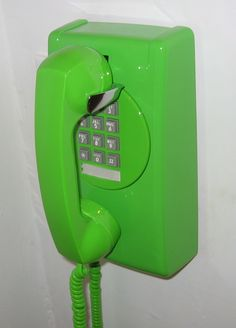 Bright green wall phone.