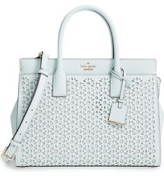 This light and lacy satchel is a perfect match for any spring ensemble
