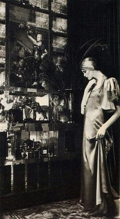 "Biba (1960s London rediscovers 1920s-30s) Original Kensington boutique started by Barbara Hulanicki (w/ copies of B. Bardot dress) Popular mid 60s-70s.Biba'selongated vintage-inspr'd ""look""-cloches turbans trailing scarves fitted puffcap + bell slv's dk berry colors-Kensington store was its own world - ""must"" for bright young things of late 60s London... (Label recently revived by new company...)"