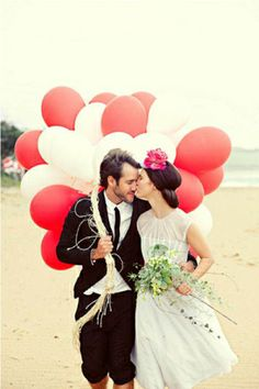 Couple on Beach with Balloons