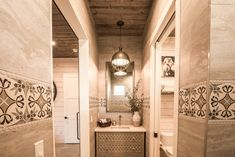 Guest bathroom with floor to ceiling tile walls and tongue and groove ceiling. Tongue And Groove Ceiling, Construction Services, Residential Real Estate, Parade Of Homes, Design Firms, Bathroom Inspiration, Wall Tiles, Service Design, Walls