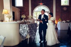 Bride and Groom Walking in for the Reception -  RSVP: The RiverRoom Blog