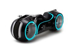 """Evolve Xenon: the """"Tron motorcycle""""  Believe it or not, this is a motorcycle that you can buy. It'll cost you at least $55,000 but it's electric, so you'll save money on gas. The Xenon was styled by Florida-based Parker Brothers Choppers, and it's based on the gas-powered """"Light Cycle"""" they created for the movie Tron: Legacy."""