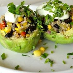 13 Creative and Healthy Stuffed Vegetable Recipes: Spicy Quinoa Stuffed Avocados with  Corn, Cilantro, Cashews.