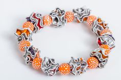 Upcycling Armband mit Kapseln in orange