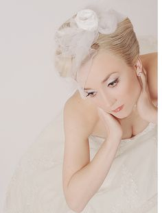 Elegant unique 2010 wedding hairstyle picture.PNG