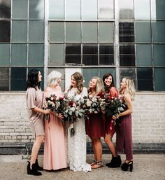 red bridesmaids in mismatched colors and designs