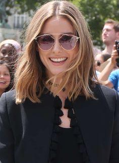 36c3b6ac0ef08 Olivia Palermo wearing a black tassel jacket and Dior