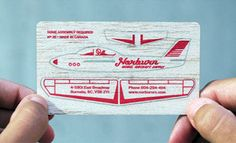 Business card on balsa wood that turns into a glider. Ingenious