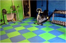 "Awesome DIY home gym using our 5/8"" Reversible Soft Tiles! For more info, visit: http://www.rubberflooringinc.com/interlocking-tile/foam/58-reversible-soft-tile-seconds.html"
