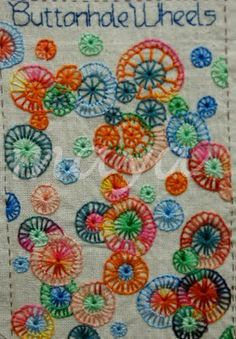 Million Little Stitches: TAST - Buttonhole Wheels...Take A Stitch Tuesday...each week a different stitch is tackled. Love it!