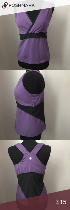 Areté Purple & Black Workout Top - L Awesome workout top by Areté is purple with sheer black. This size large top has a wrap front and racerback styling. This top is in amazing condition and ready to ship from a non smoking home. Areté Tops