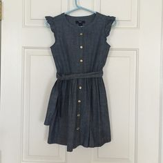 Girls Chambray Sundress Adorable, chambray dress with a tie around the waist and ruffled cap sleeves. GAP Dresses