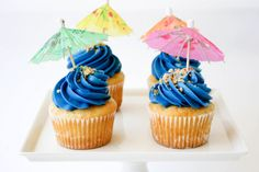 Feel like a splurge?! Beach Umbrella Cupcakes Recipe for a Pool Party #SelfMagazine #party #cupcakes
