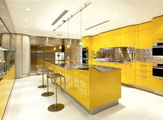 Have seen kitchens from the Old Hollywood genre and they look similar to this.  Modern Yellow Kitchen by Snaidero