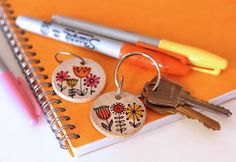 Sharpie drawings on wooden disks make key chains