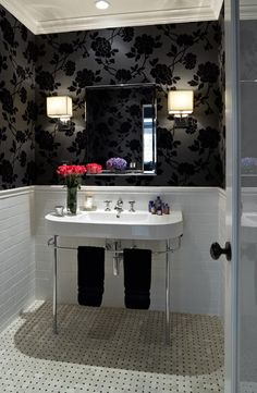 chair rail in feminine chic bathroom design, glossy black floral wallpaper, subway tiles, polished chrome washstand, marble basketweave floor, black, hand towels and modern square sconces Courtesy Jean Randazzo Photography (decorpad.com)