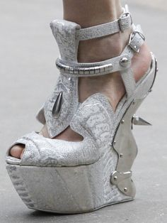 spiked wedge -- seriously, what is wrong with some people? | Love incredible shoes? Follow http://www.pinterest.com/thevioletvixen/insane-shoes-i-love-but-could-never-afford/