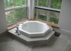 Small Japanese Soaking Tub with waterfall shower over for tiny house