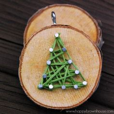 This rustic DIY Wood Slice String Art Ornament is simple to make and looks beautiful on the Christmas tree. Give as a gift or add to the top of a present for a creative giftwrap idea. Inspired by a Christmas children's book, this kid's Christmas ornament is perfect for fine motor skills practice.