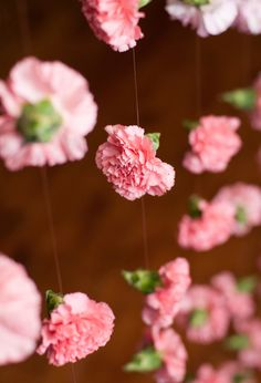 Hanging fresh flowers gave the wedding a unique romantic look. {Blume Photography}