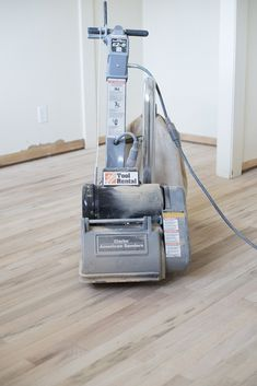 How to Refinish Hardwood Floors Like a Pro - Room for Tuesday sanding-hardwood-floors<br> Do your floors need refinished? I'm sharing an extremely detailed tutorial of how to refinish hardwood floors like a pro! Sanding Wood Floors, Refinishing Hardwood Floors, Diy Flooring, Flooring Ideas, Diy Sanding, Hardwood Floor Care, Sand Floor, Renovation Budget, Home Remodeling Diy