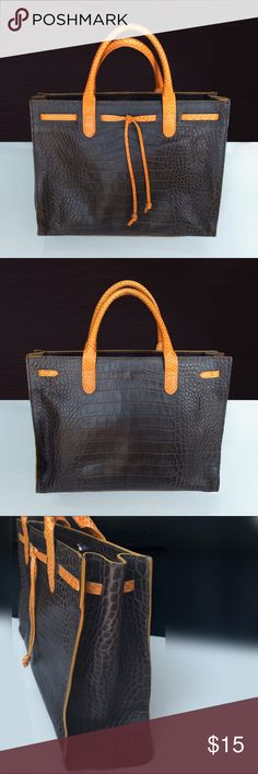 """Italian Leather Tote Bag, by Claudia Firenze This cute brown 100% genuine Italian leather tote bag is made by designer Claudia Firenze. Great for work or for casual outings. Orange drop ties and handle details. Inside has zipper and cellphone compartment. Magnetic closer inside. Gently used pre-owned condition, no obvious scratches or marks. Inside is clean and free of marks. Beautiful Italian leather tote and at an affordable price! Height 10"""", from top of handles 14.5 """"x width 12.5""""x depth…"""