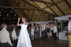 lovely pic again full of action where the bride throws her bouquet to her friends