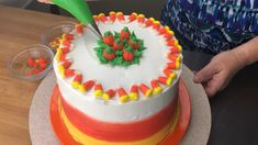 Easy to make Halloween cake using candy corn and candy pumpkins.