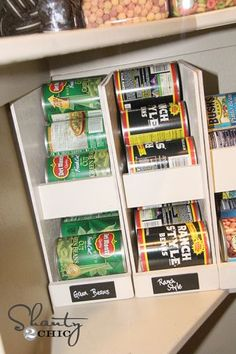 DIY Canned Food Organizers  With a family of 7 to feed, my canned food stash was going a bit crazy. I designed and built wood organizers that rotate the oldest dates out first.This one will hold up to 12 cans... Woohoo! The others will hold up to 7 and are stackable. Plus... They cost under $5 a piece to build! You can see the full set of easy plans with lots of photos and tips at http://www.shanty-2-chic.com/2012/10/pantry-...  #Bestof2012