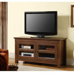 @Overstock - 44-inch Brown Wood TV Stand - Make a special place for you television and entertainment equipment with this TV console. In a stylish brown color, this entertainment center will support up to 48-inch flat panel TVs.  http://www.overstock.com/Home-Garden/44-inch-Brown-Wood-TV-Stand/5389791/product.html?CID=214117 $219.99