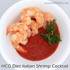 "HCG SHRIMP COCKTAIL  100 grams (3.5 ounces shrimp) 2 tablespoon ""Homemade Chicken Broth"" 1 clove garlic minced* 3 tbsp dried parsley 1/8 tsp sea salt 1/8 tsp black pepper 8 ounces of the Simple Girl Tomato Italiano Sauce 1/2 of a lemon for serving"