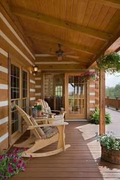 Exterior, vertical, rear porch with rocking chairs, DeSocio residence, Henry, Tennessee, Honest Abe Log Homes on Log Homes, Timber Frame and Log Cabins by Honest Abe http://www.honestabe.com/social-gallery/arcd-5077